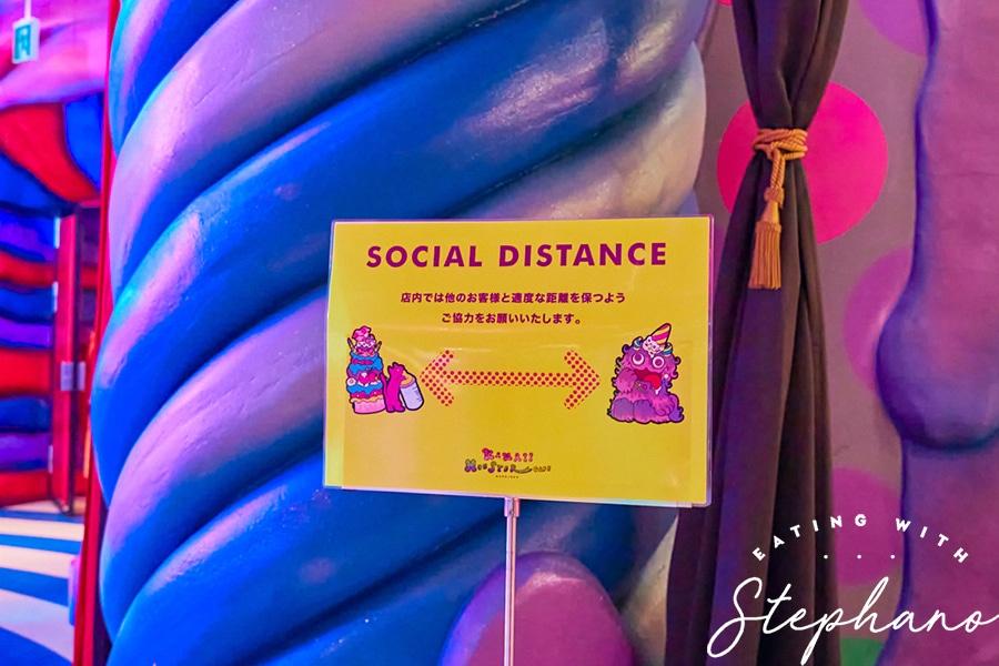 kawaii monster cafe social distance sign