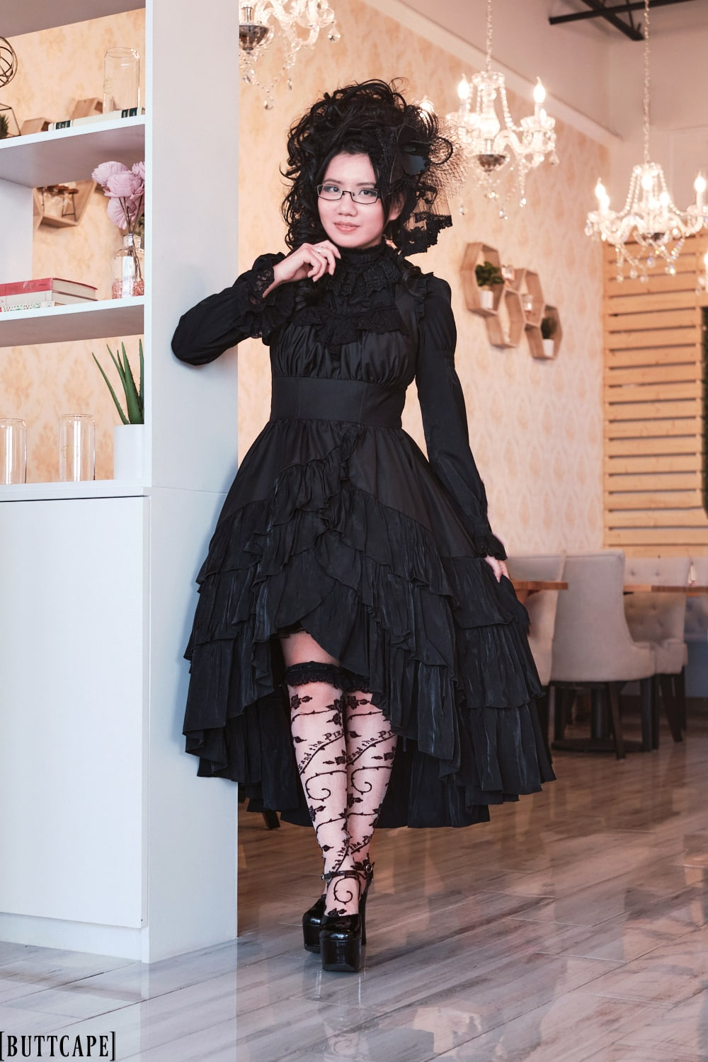 all black gothic lolita outfit with Sheglit Finsternis Dress, Sheglit Arcturus Tuck Blouse, Alice and the Pirates See Through transparent Rose OTK socks, and platform shoes inside Proper Rose Garden